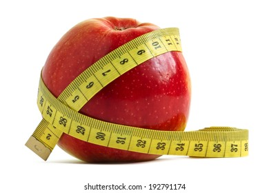 Red apple and measuring tape over white - the concept of diet and fitness