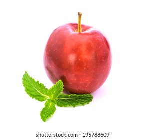 red apple with mint isolated on white background