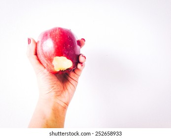 Red apple with missing a bited on hand in isolate on white background.