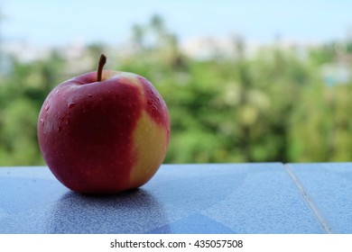 Red apple in the morning on natural background.
