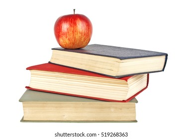 Red apple and old books isolated on white background