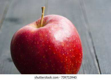 red apple on black wood table background