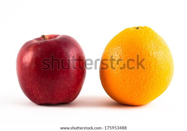 Red apple and an orange isolated on white.