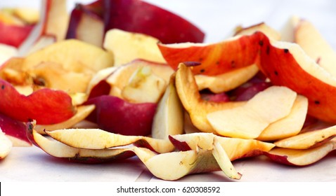 Red apple Peels with white background, close up shot,shallow dof, focus on foreground