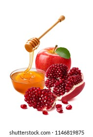 Red apple, pomegranate and honey bowl for Jewish New Year. With clipping path. Isolated on white background