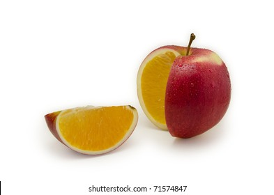 Red apple sliced, juicy orange inside. Isolated on white background
