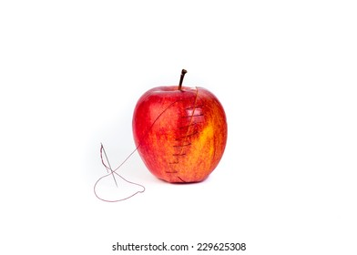 Red Apple Sliced And Stitched Back Together