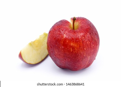 Red apple sliced with water drop isolated on white background.