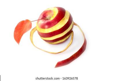 Red apple in a spiral of peel macro