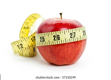 Red apple and Tape Measure close up