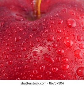 Red apple with water drops macro shot