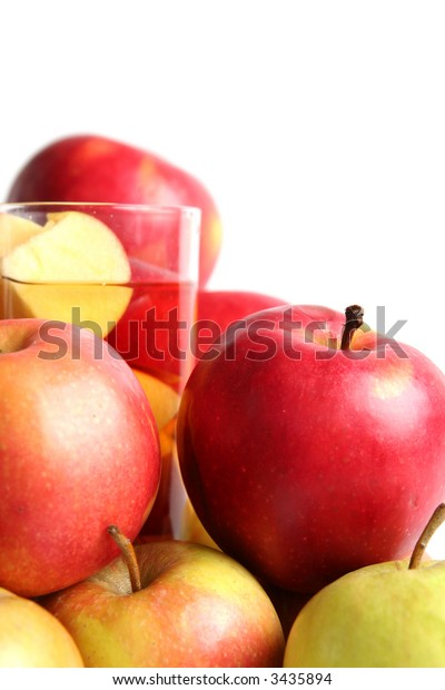 Red apples and apple juice on a white background