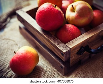 Red apples box in rustic style