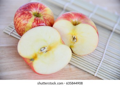red apples for healthy dessert on wooden background