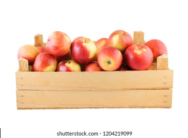 Red apples in old wooden crate isolated on white