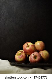 red apples on a dish