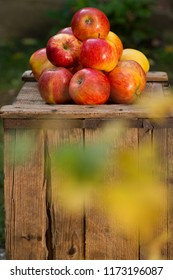 Red apples on the old wooden crate