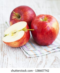 Red Apples on a old wooden background