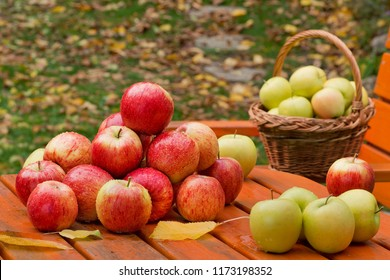Red apples on the table in garden
