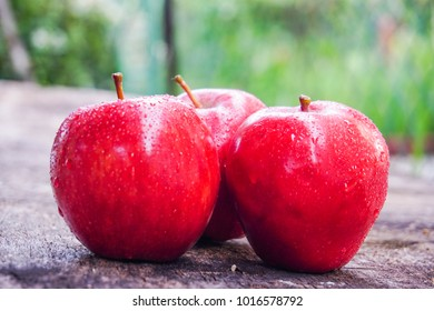 red apples on wooden table background