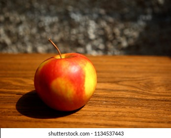 Red apples and on wooden table, autumn harvest