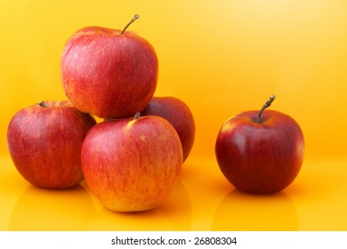 Red apples on yellow background.