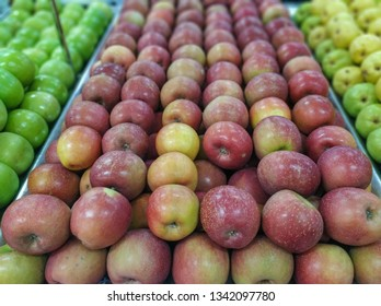 red apples for sale in supermarket in hortifruti section with blurred background