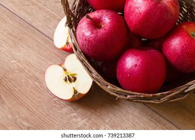 Red apples in a wicker basket