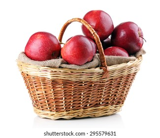 Red apples in wicker basket isolate on white