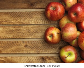 Red apples in wooden box. Copyspace