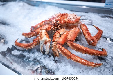 red arctic snow crab on ice in market