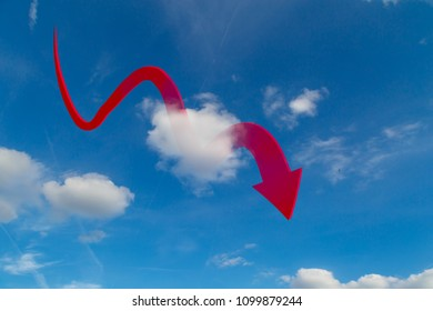 Red arrow drop down in clouds on blue sky.