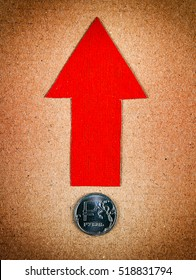 Red Arrow with Russian Ruble Up on the Old Paper Background