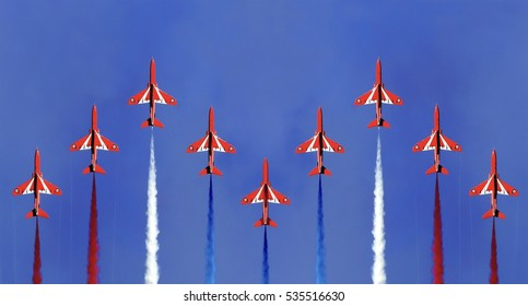 The red arrows display formation Cornwall England with a blue sky background.