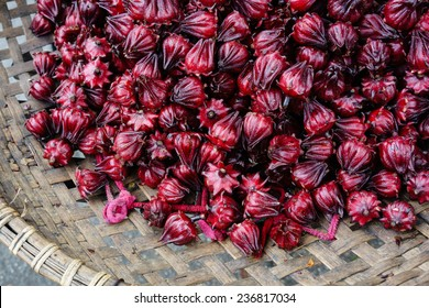 Red artichoke flowers is placed in baskets of hawkers in Hanoi, Vietnam