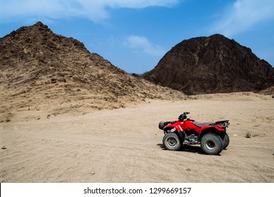 Red ATV without people in the desert, Egypt. Desert Safari. May 2018. Sharm El Sheikh