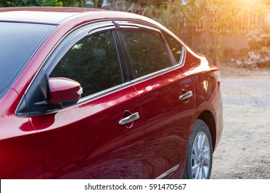 Red auto window or automobile motor car of shiny convertible luxury outside background,transportation trip concept
