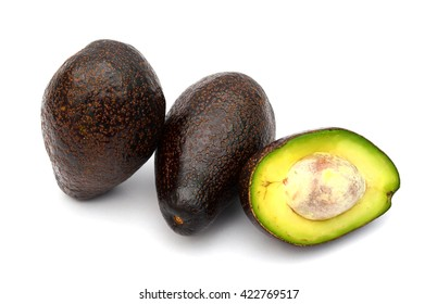 red avocados isolated on white