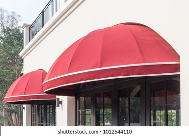 red awning over door and concrete wall background, free copy space for text