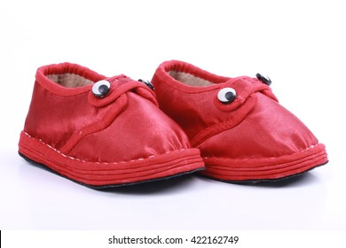 Red baby shoes isolated on white background