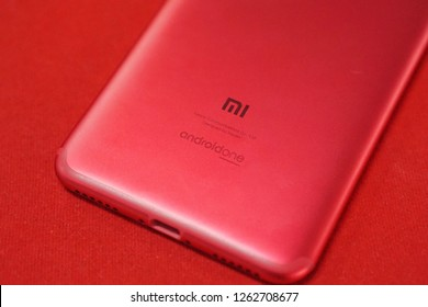 Red back of Xiaomi Mi A2 with Android One logo
