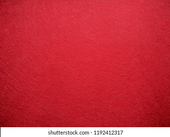 Red background of felt with carpet texture.