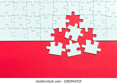 Red background made from white jigsaw puzzle pieces and place for your content