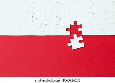 Red background made from white puzzle pieces and place for your content