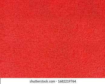 the red background from synthetic fiber carpet