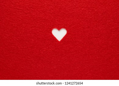 Red background with white Valentine's heart. Copy space for text