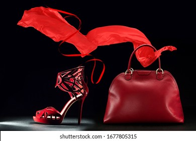 Red bag scarf and shoes on the black background
