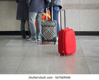 Red baggage is standing in the terminal or airport. lost concept