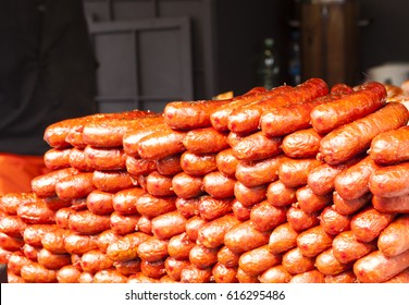 Red baked delicious juicy sausages in Prague easter market