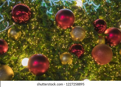Red ball with bokeh LED light decoration on the Christmas tree.  Happy new year, To Celebrate Chirstmas
